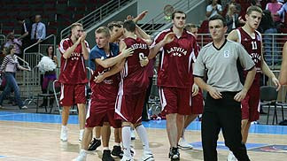Latvia celebrate their win over Russia.