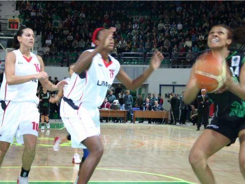 Ekaterinburg's Yamile Calderon and Ticha Penicheiro look on while Kelly Santos gets an easy two