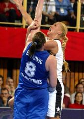 Pecs' Annamaria Keller works inside against Suzy Batkovic