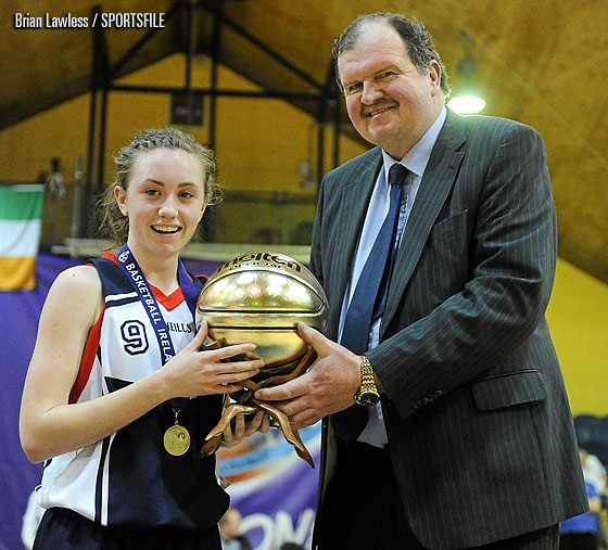 Bernard OByrne, Secretary General of Basketball Ireland, presents Megan OLeary, St.Vincents, Cork, with the player of the match award.