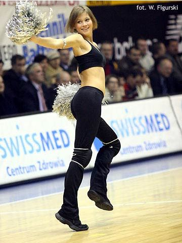 One of the Gdynia cheerleaders entertains the fans at halftime