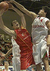Deyan Ivanov (Bulgaria) blocking a shot