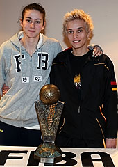 Olcay Cakir and Isil Alben posing with the EuroLeague Women trophy