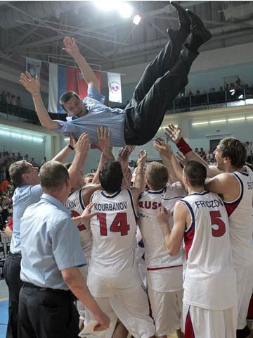 Russia celebrate victory at the ACI Trading Ltd U20 European Championship with coach Evgeny Pashutin
