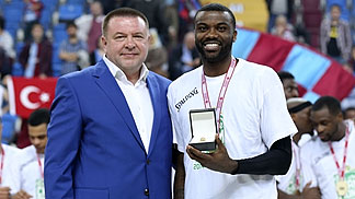 Sergey Fomin, President of the Olympic Sports Studio, presents Jamal Shuler with the Final Four MVP award