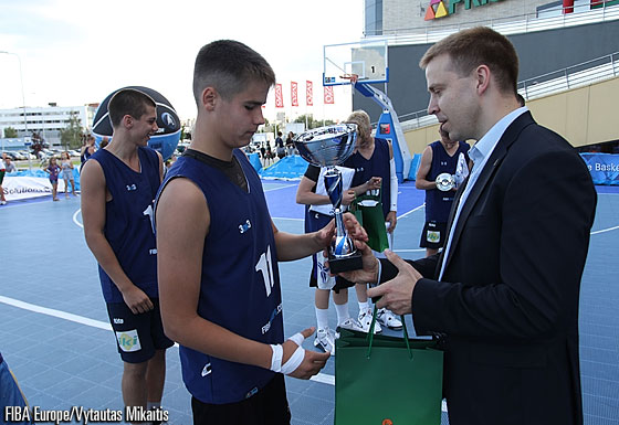 Lithuanian Basketball Federation Managing Director Paulius Motiejunas presents hunior with their awards at the FIBA Europe 3on3 in Vilnius, Lithuania - 18 August 2012