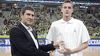 U18 All Star Game MVP Anzejs Pesecniks being handed his trophy by FIBA Europe Youth Commission President Asterios Zois