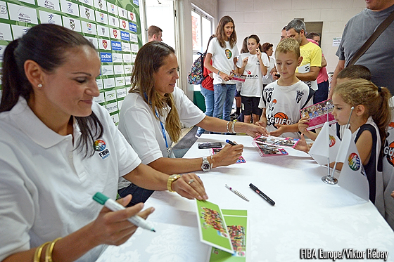 Portuguese legend Ticha Penicheiro and FIBA Europe Women's Ambassador Amaya Valdemoro sign autographs for fans at half-time in the Czech Republic - Portugal game