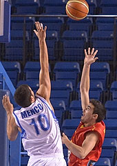 Spains Jaime Fernandez launches the game winner over Israels Rafael  Menco