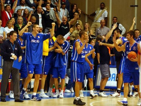 Players of Serbia and Montenegro celebrate after the victory against Turkey.