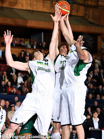 Three DKV Joventut players secure the rebound