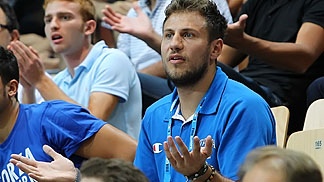 Italys Stefano Mancinelli following his teammates from the stands