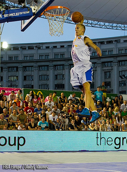 Latvian dunker Kristaps Dargais rising above the rim