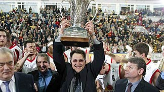 Unics Kazan coach Stanislav Eremine with the trophy