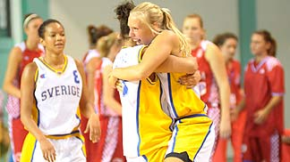 Two Sweden players celebrate a win over Croatia