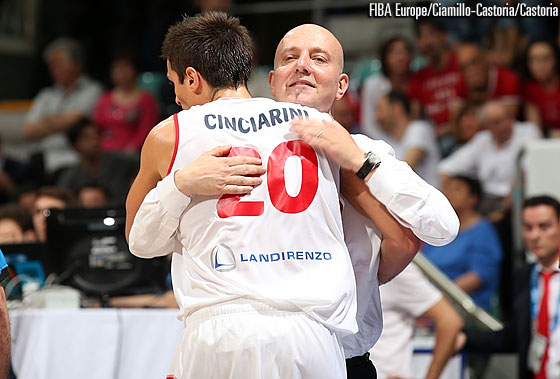 Andrea Cinciarini gets a hug from head coach Massimiliano Menetti