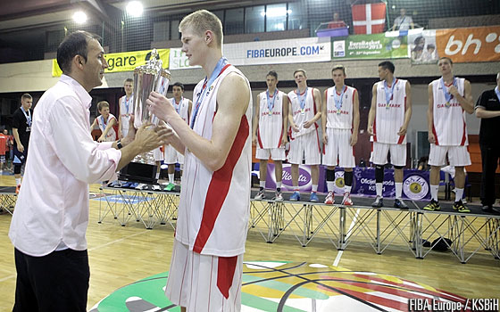 Denmark's Jacob Larsen receives the trophy from Bosnia and Herzegovina Basketball Federation Secretary General Harun Mahmutovic