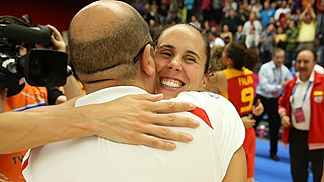 Coach Lucas Mondelo congratulates Amaya Valdemoro on her 254th national team cap