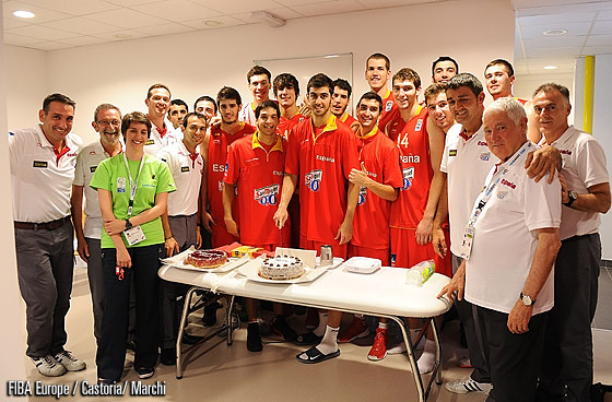 Spain player Miguel Servera cuts his birthday cake in the locker room after the end of the game