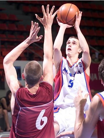 Ivan Karavaev (Russia) guarded by Latvia's Ugis Bers
