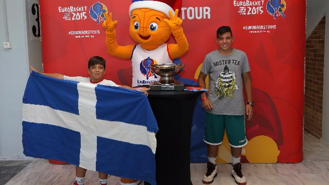 Fans get up close to the EuroBasket 2015 Trophy prior to a friendly game between the Greek and USA U19 teams