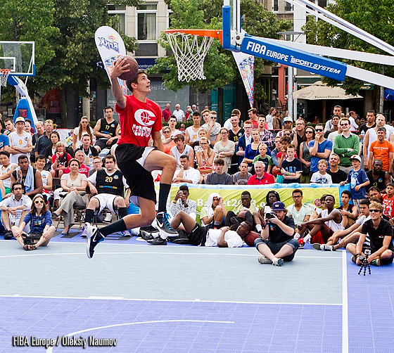 Jere Vucica goes up for a dunk between his legs