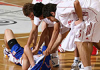 Turkish players comfort Stefan Markovic (Serbia & Montenegro) after their win