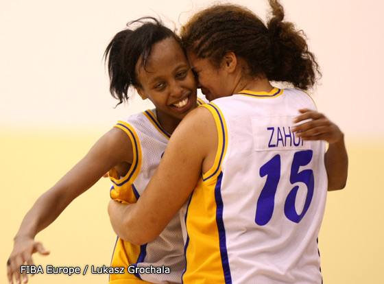 Farhiya Abdi and Amanda Zahui celebrate victory over Lithuania