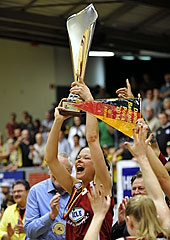 Anne Breitreiner holding aloft the German Cup