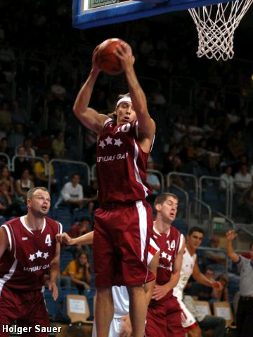 Latvia's Sandis Valters secures the boards against Turkey