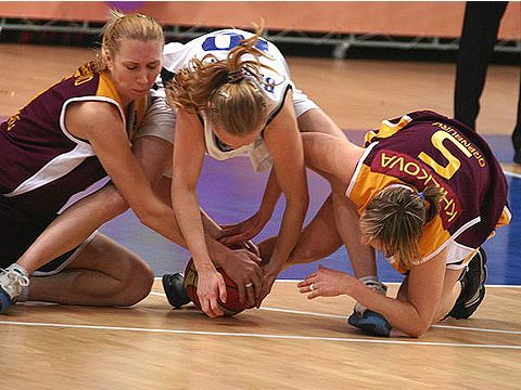 Elena Beglova (BC Dynamo Moscow Region) and Elena Khilkova (NADEZHDA) battle for a loose ball.