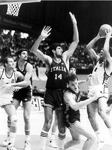 Greece's Nik Galis attempts to shoot over Ario Costa at the 1987 European Championship in Greece